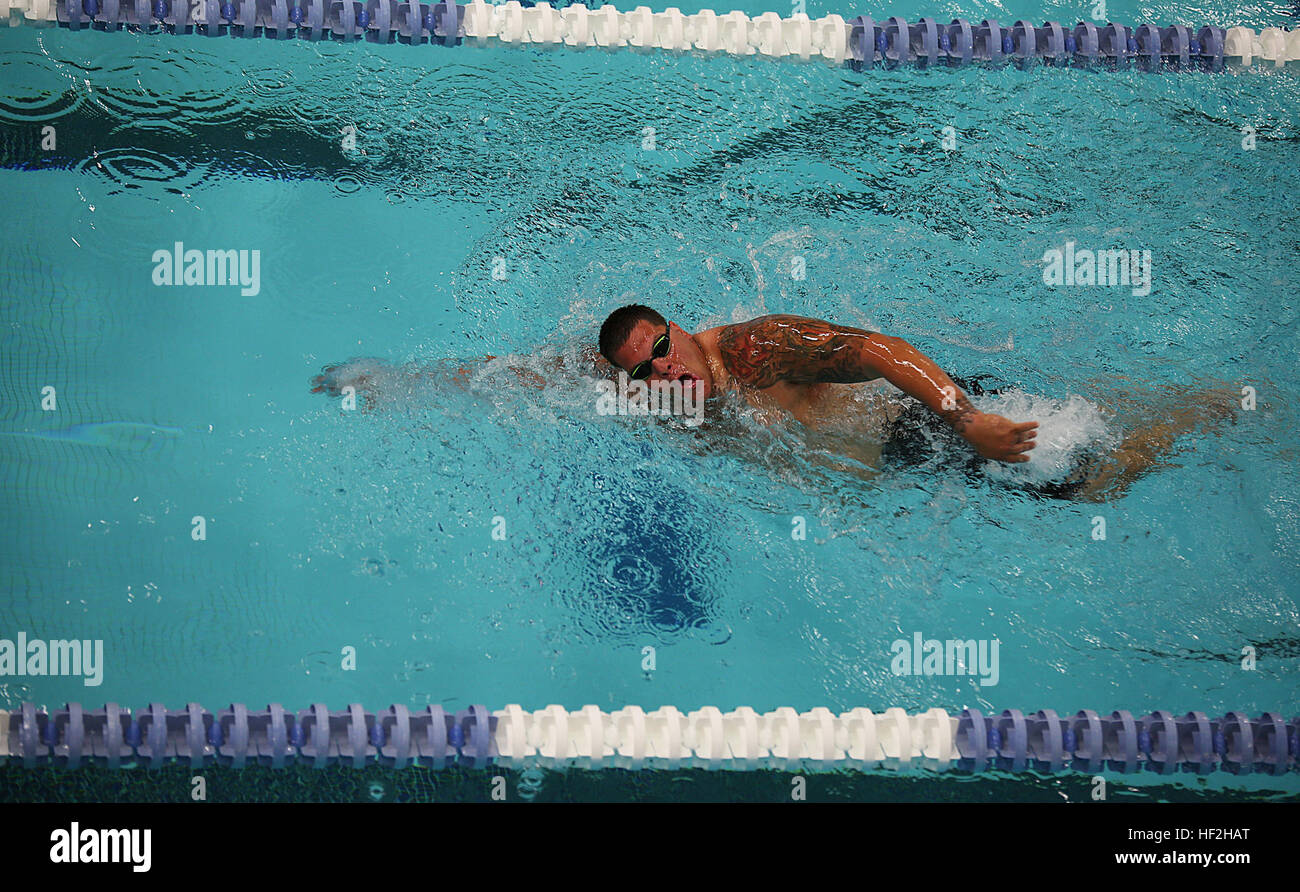 Sgt. Michael Wishnia, from Livingston, New Jersey, races to finish the 100-meter freestyle swim at the 2014 Warrior - Stock Image
