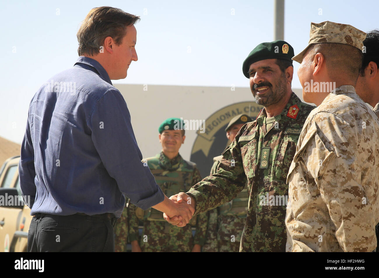 U.K. Prime Minister David Cameron meets with Maj. Gen. Sayed Malouk, commander of Afghanistan's 215th Corps, and Stock Photo