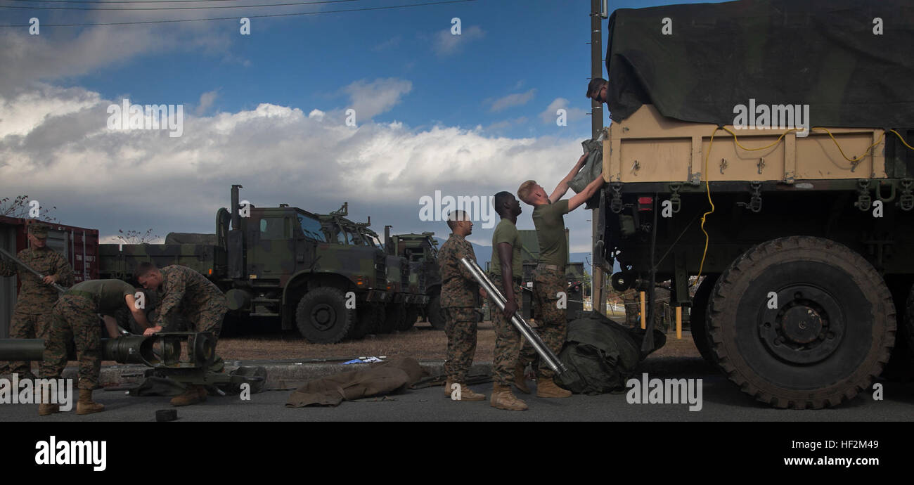 Marines unload a 7-ton truck Oct. 30 during a command post exercise for Artillery Relocation Training Program 14 - Stock Image