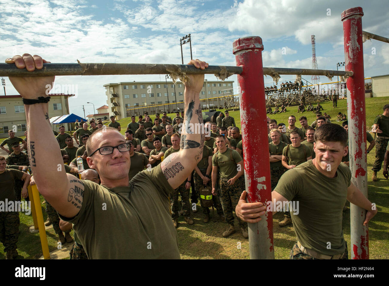 Cpl. Zach Martin from Cleveland, Ohio, struggles for one more repetition at the pull up challenge Nov. 14 during - Stock Image