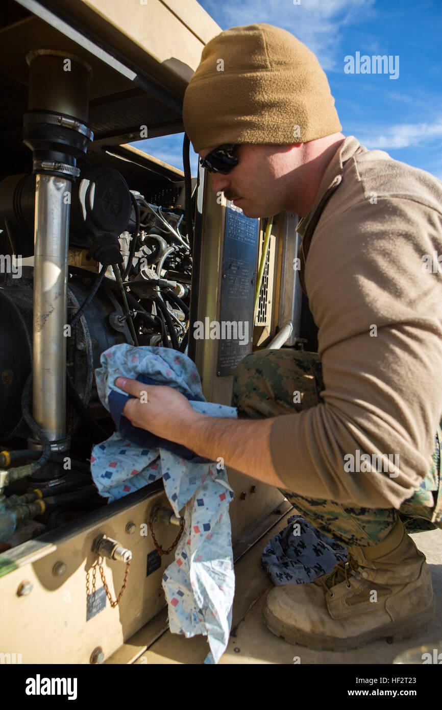 us marine cpl brandon hirsch a generator mechanic with combat logistics battalion 26 2nd marine logistics group cleans a generator on the us marine