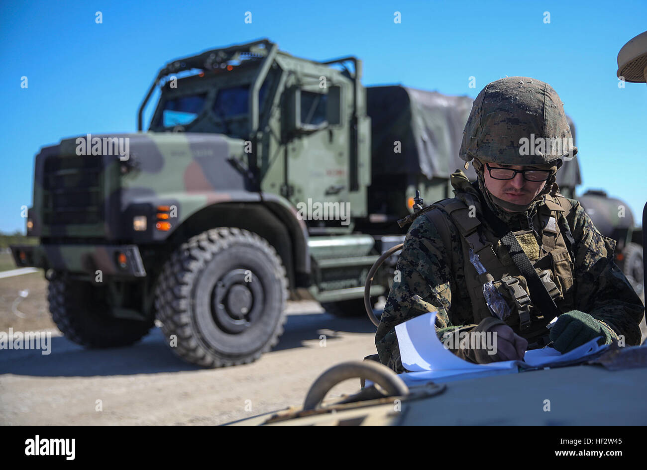 Lance Cpl. Devyn Hodges, an entry control point guard and motor transport operator with Headquarters Battalion, - Stock Image