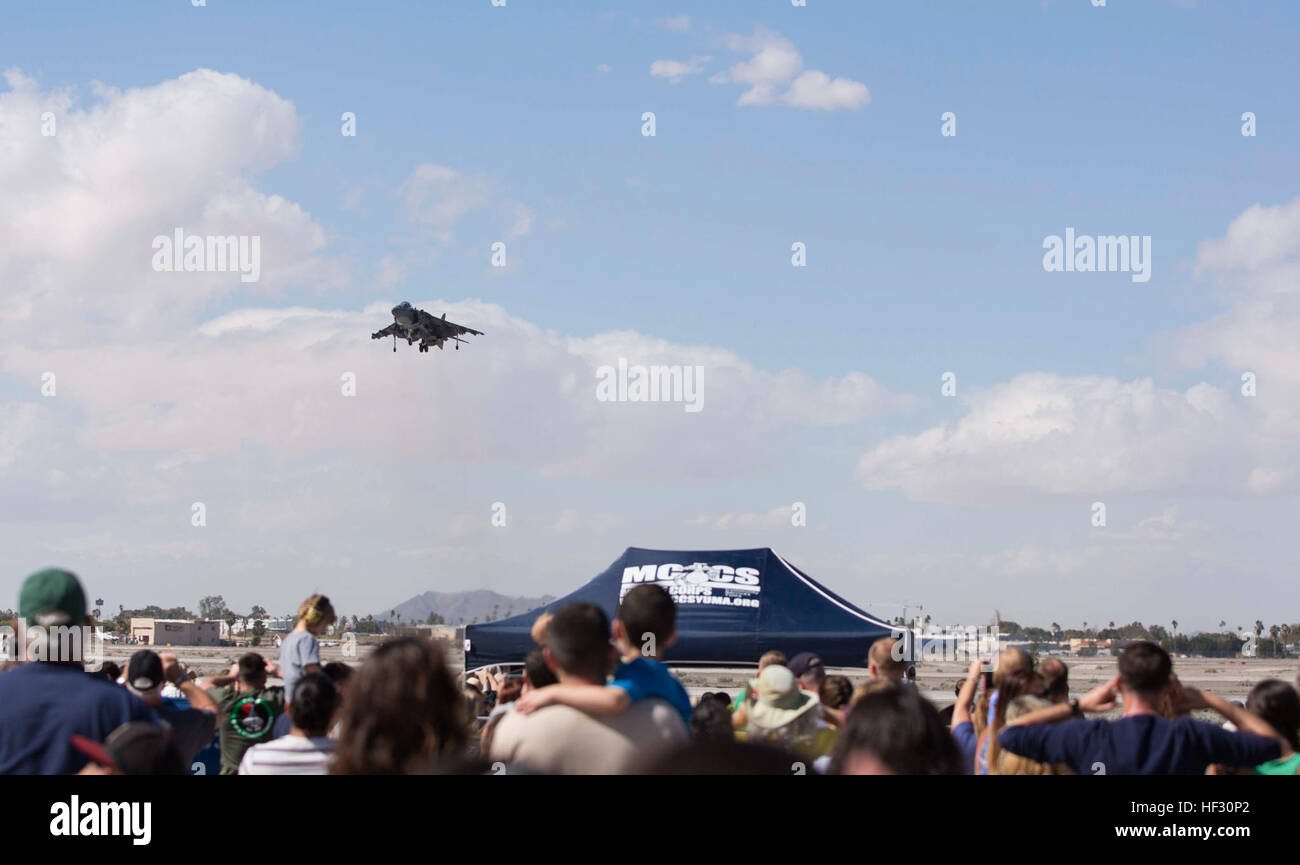 During the annual Yuma Airshow, an AV-8B Harrier hovers during its performance for the crowd at Marine Corps Air Stock Photo