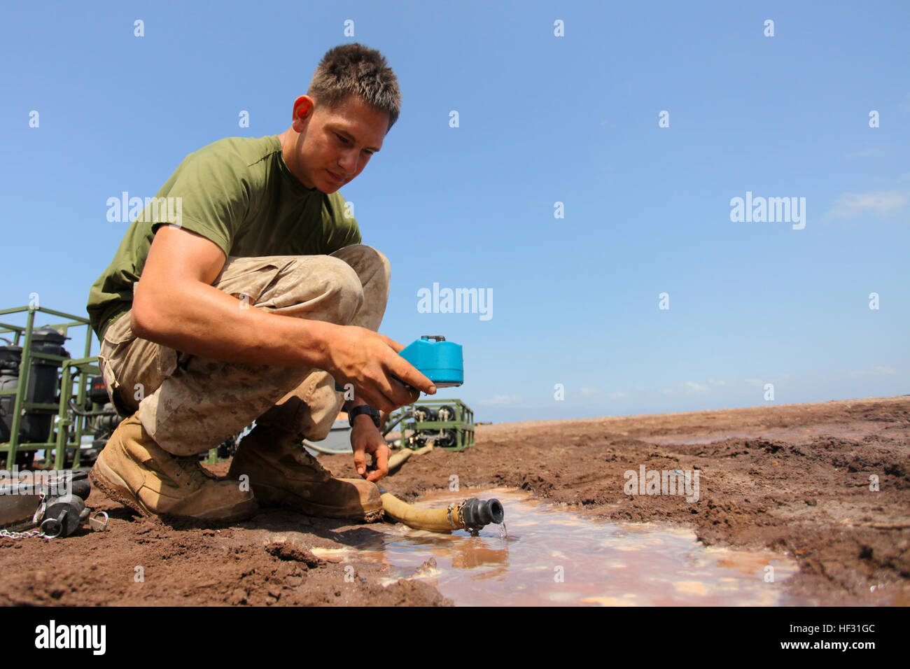 Corporal Ryan G. Schmidt, a water purification specialist with Combat Logistics Battalion 24, 24th Marine Expeditionary - Stock Image