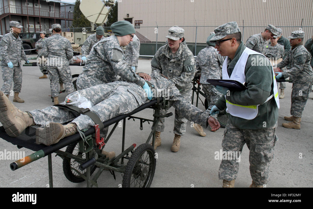 Soldiers Assigned To The 121st Combat Support Hospital 65th Medical Brigade Evaluate And Transport Simulated Casualties During Training At Yongsan