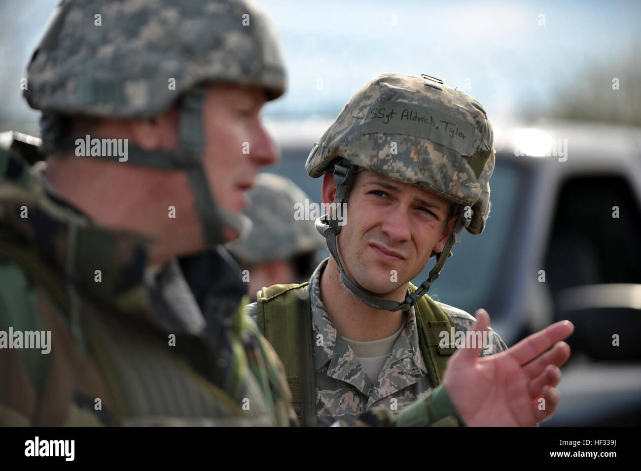Staff Sgt. Tyler Aldrich, an Air National Guard emergency manager, listens during a mission brief before taking - Stock Image
