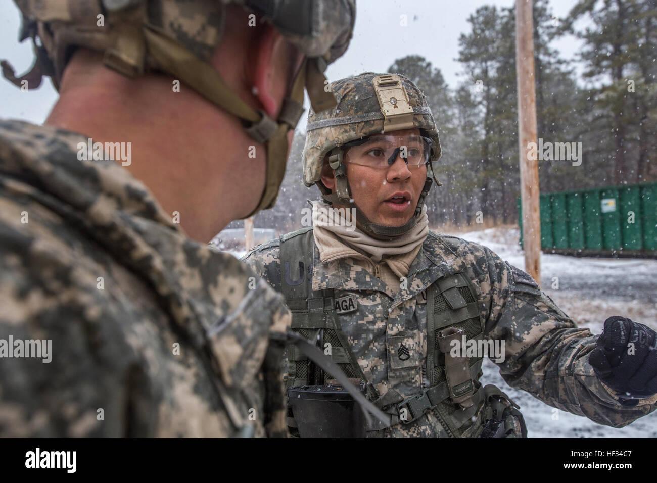 Staff Sgt. Manuel Larranaga Jr., right, evaluates Spcs. Brendan P. Boyle and Tyler J. Menz's performance at the Stock Photo