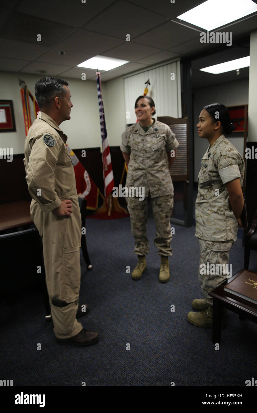 Maj. Gen. Michael Rocco, left, commanding general of 3rd Marine Aircraft Wing, speaks with Petty Officer 1st Class - Stock Image