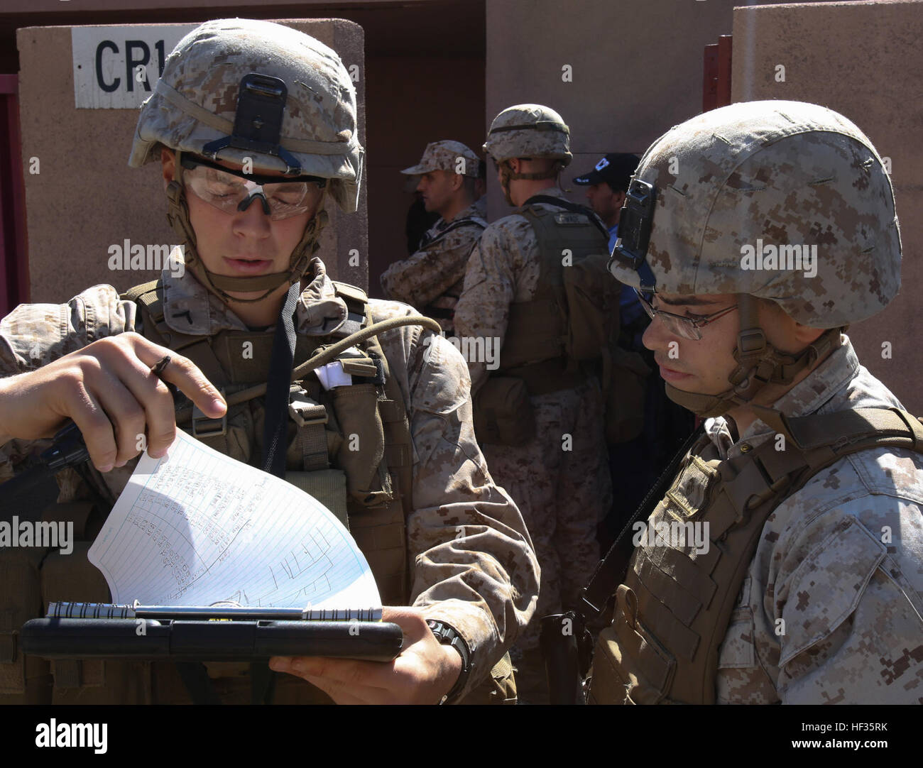 Private First Class Andrew Hartman, an automatic rifleman, and Cpl. Nelson Garrett, a fire-team leader, both with - Stock Image