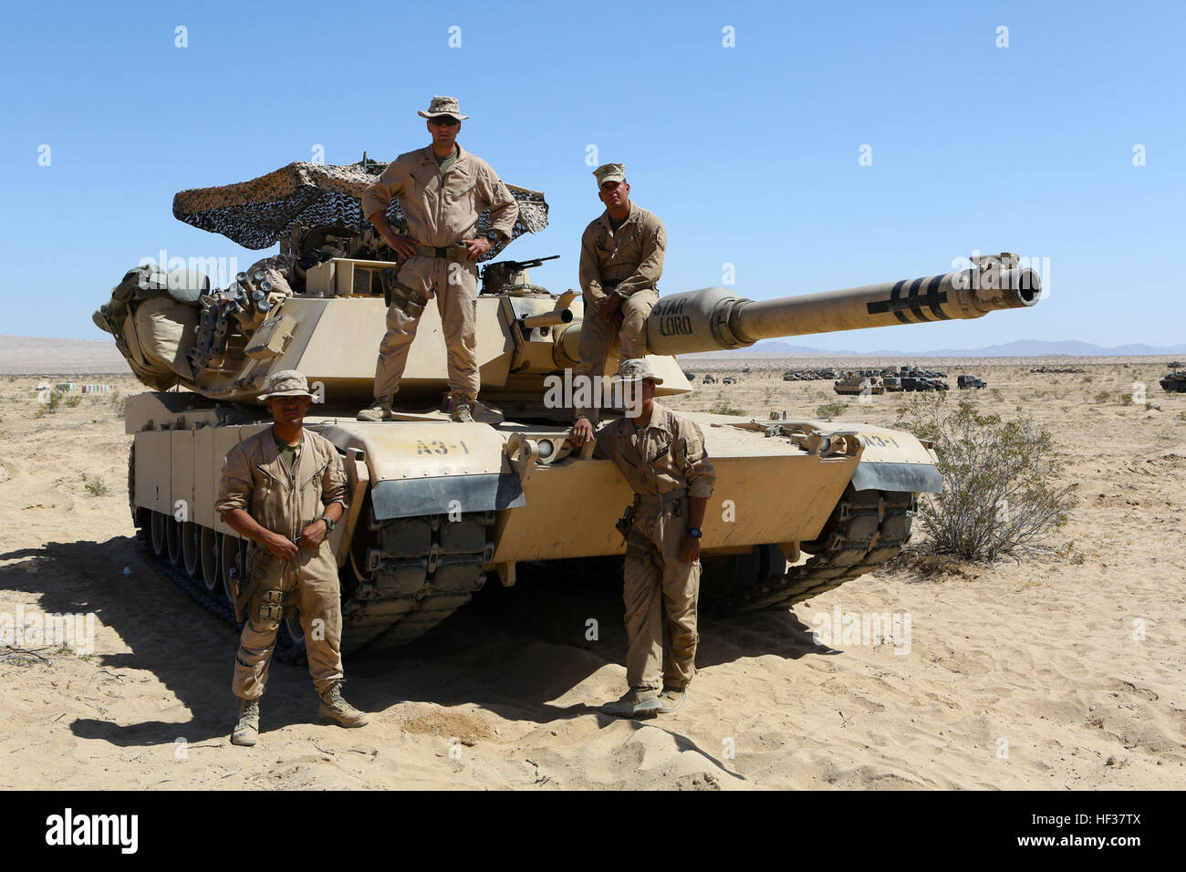 Clockwise from top left, 1st Lieutenant John Neail, tank commander, Cpl. Christian Bills, gunner, Lance Cpl. Robert - Stock Image
