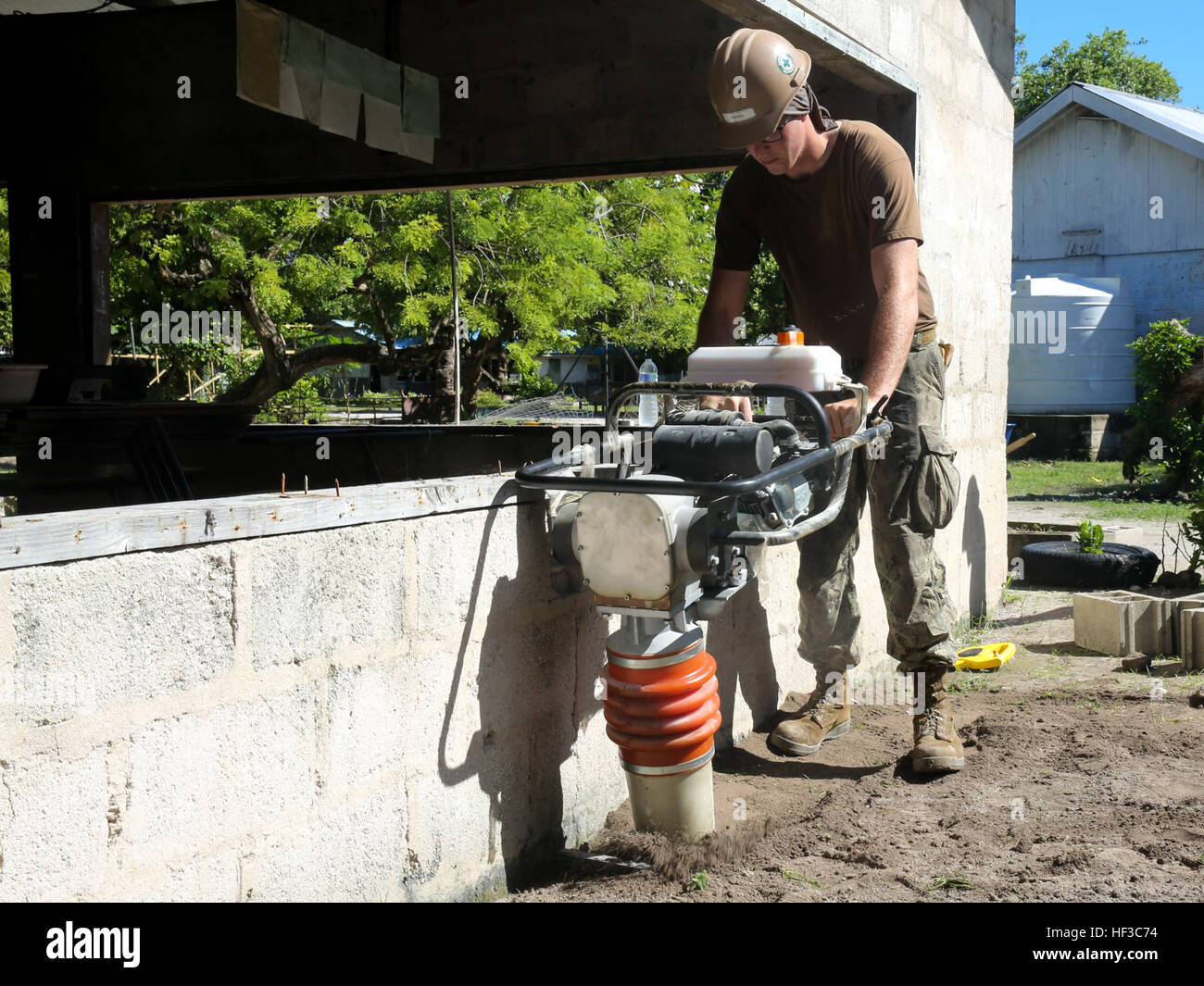 KIRABATI (June 3, 2015) – Builder 3rd Class Clint Siefers assist in remodeling a primary school as part of a of - Stock Image