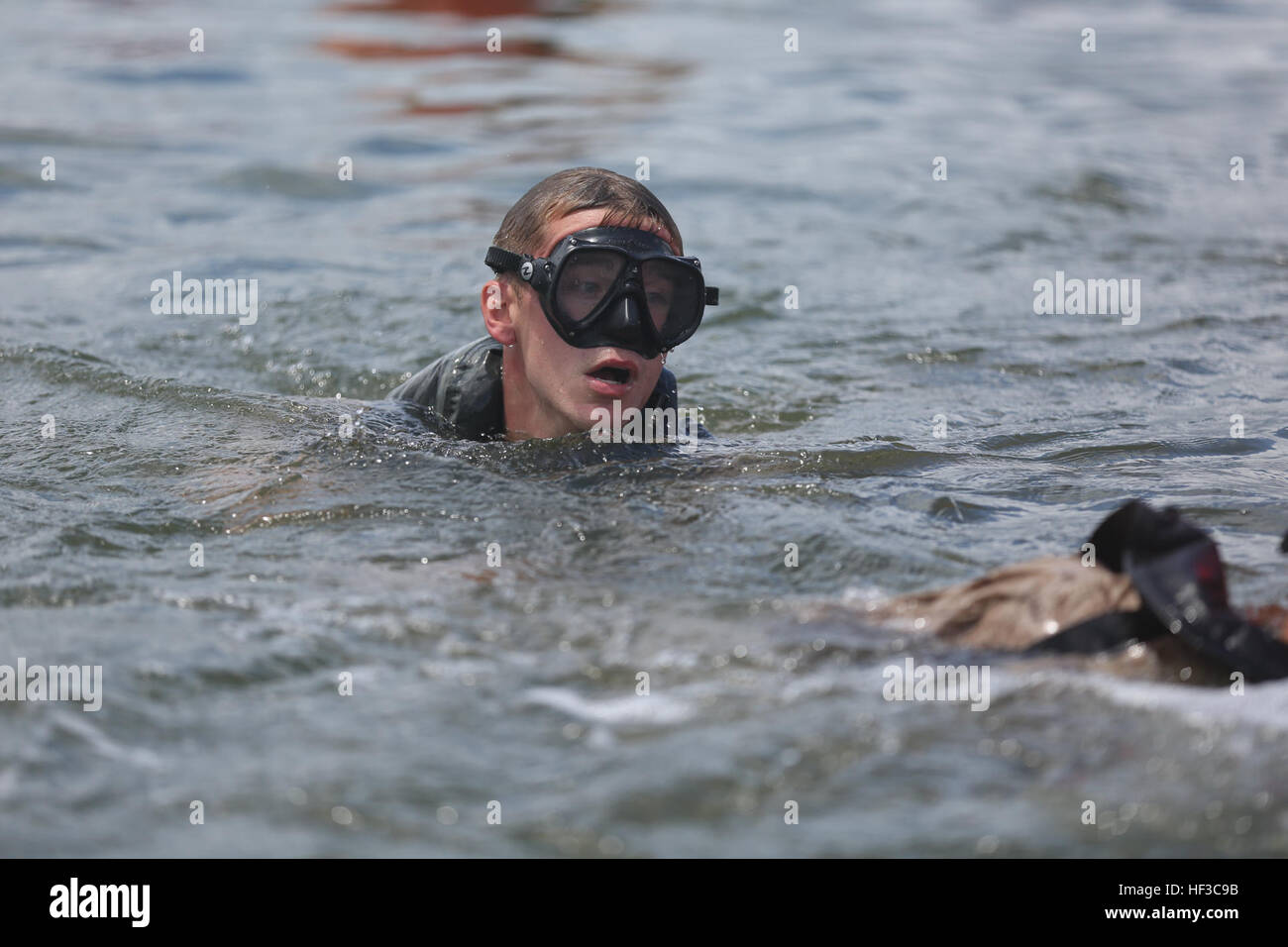 f3fa9be804b ... Marine Division, finishes an open water swim during a final training  event known as 'The Fin' during a pre-dive course aboard Camp Lejeune,  N.C., May ...