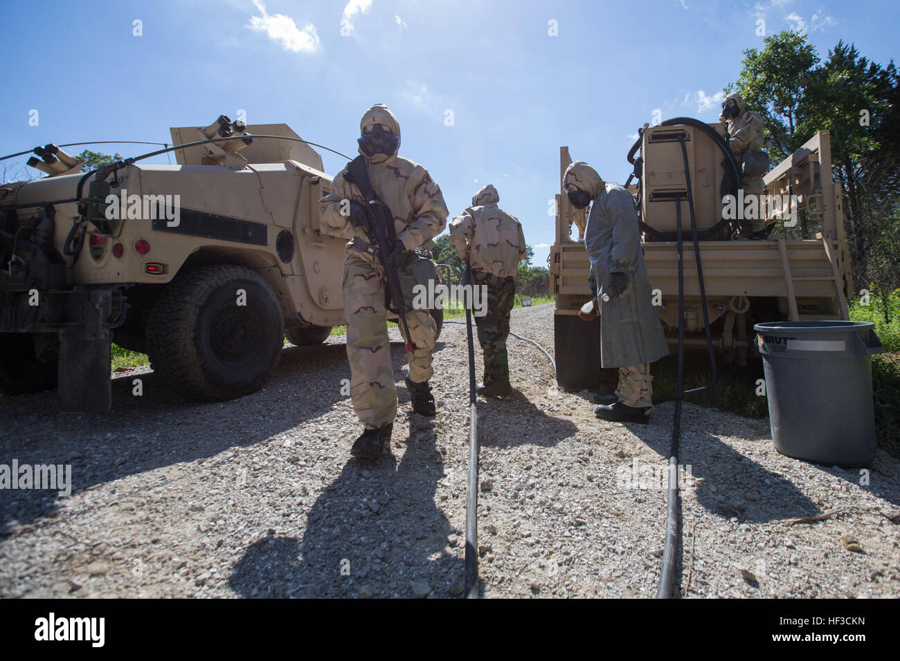 Soldiers assigned to the 3175th Chemical Company, 835th Combat Sustainment Support Brigade, exit Humvees and proceed Stock Photo