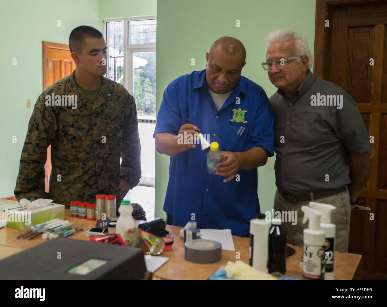 U.S. Ambassador to Belize, Carlos Moreno and U.S. Marine 2nd Lt. Spencer Toy, OIC of 2nd Law Enforcement Battalion, - Stock Image