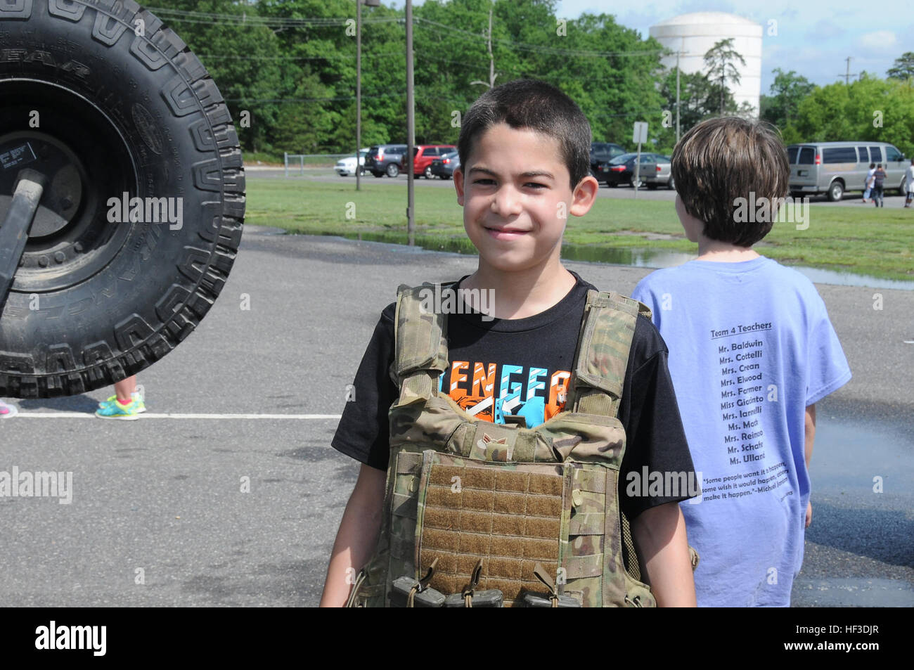 A fifth-grade student from Dr. Joyanne D. Miller School, Egg Harbor Township, N.J., wears a tactical vest during - Stock Image