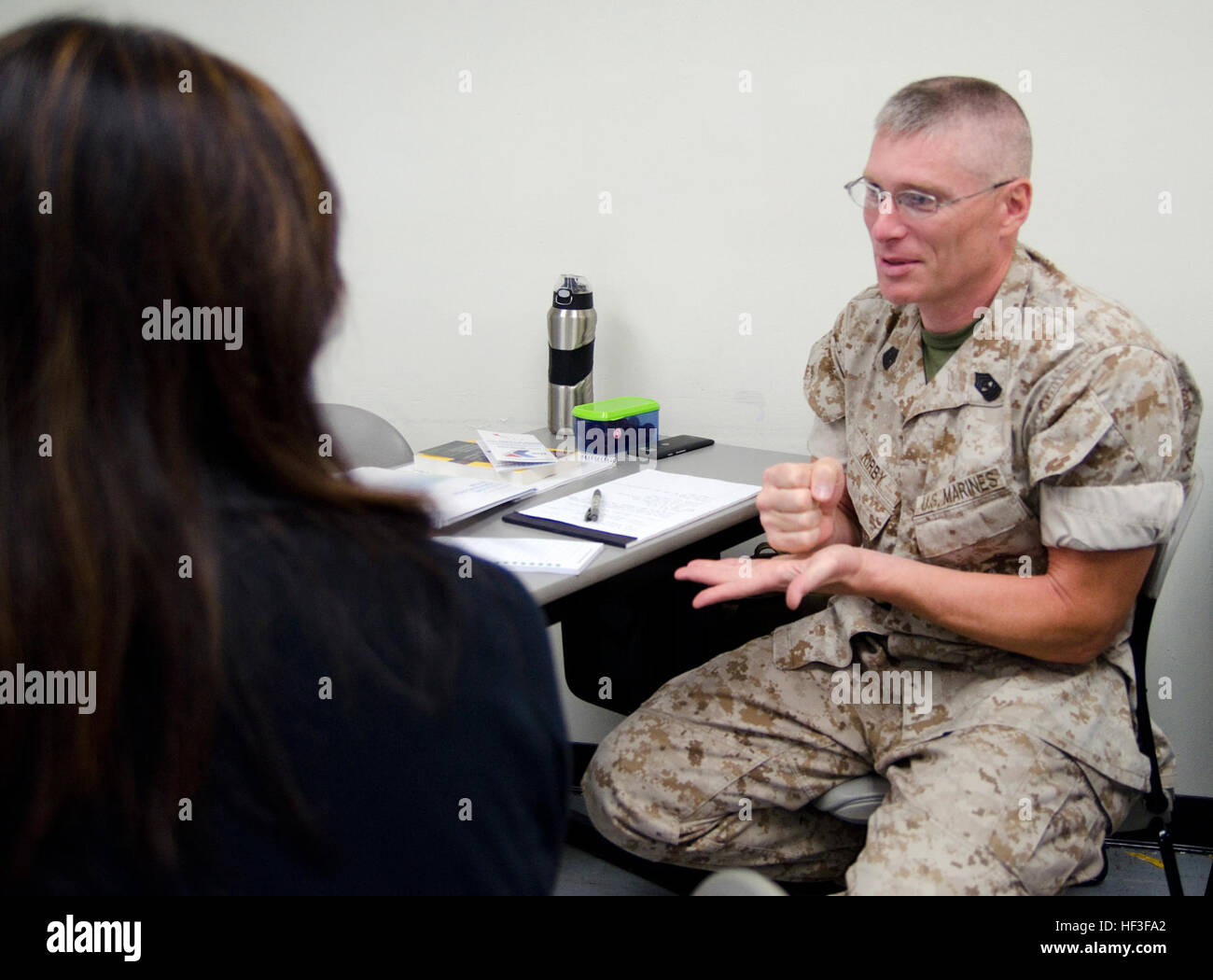 Master Gunnery Sgt. Todd Kirby, a technical control engineer at U.S. Marine Corps Forces, Pacific, goes through - Stock Image