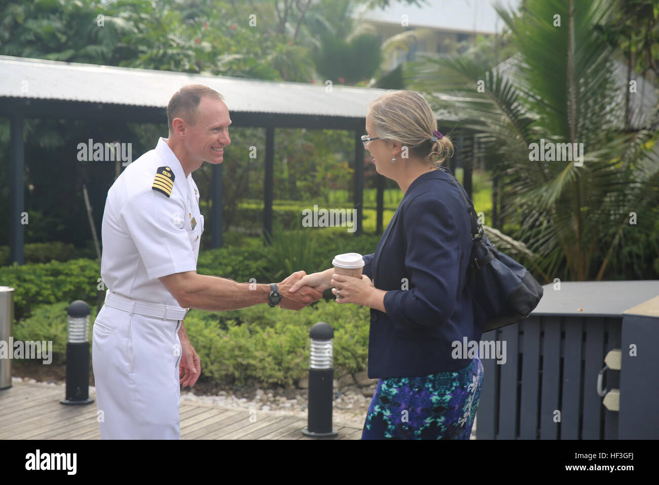 150713-M-GO800-005 HONIARA, Guadalcanal (July 13, 2015) – Commodore, Task Force Forager Capt. James Meyer greets - Stock Image