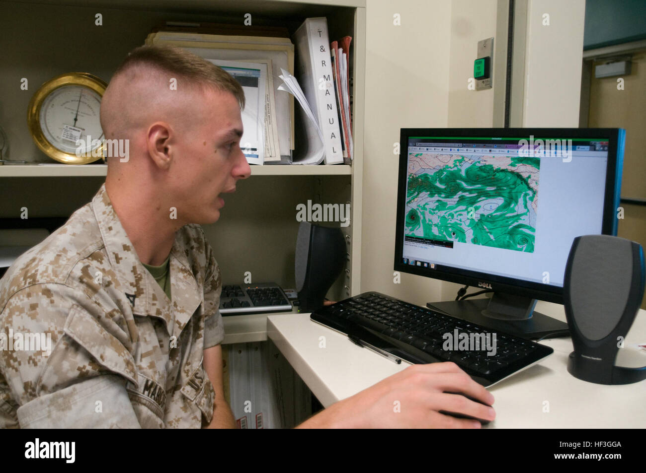 Lance Cpl. Conrad Marcoff, a forecaster for the Meteorology and Oceanography section of Marine Corps Air Station - Stock Image
