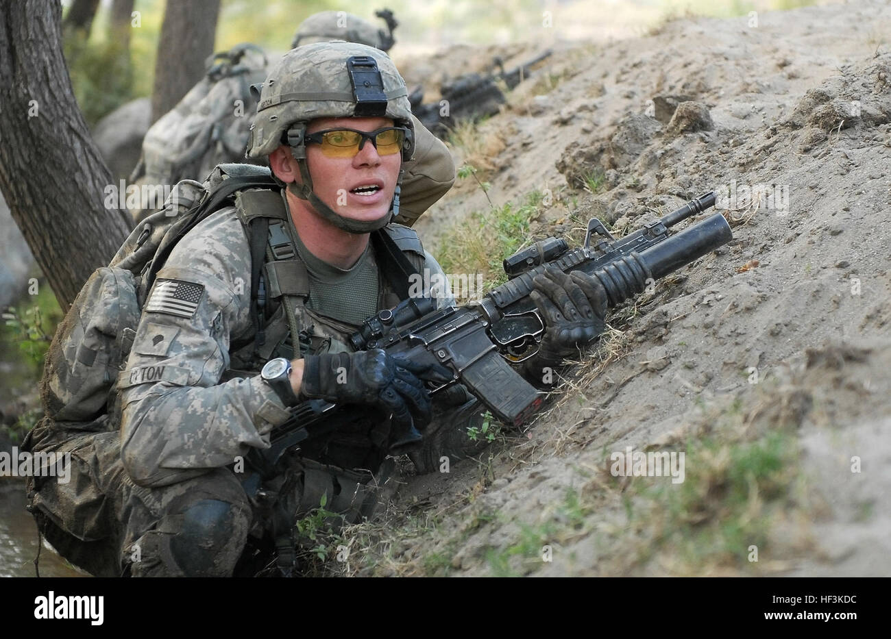 U.S. Army Spc. Thomas Upton, a native of Aransas Pass, Texas, watches for anti-Afghan forces during a gun-battle - Stock Image