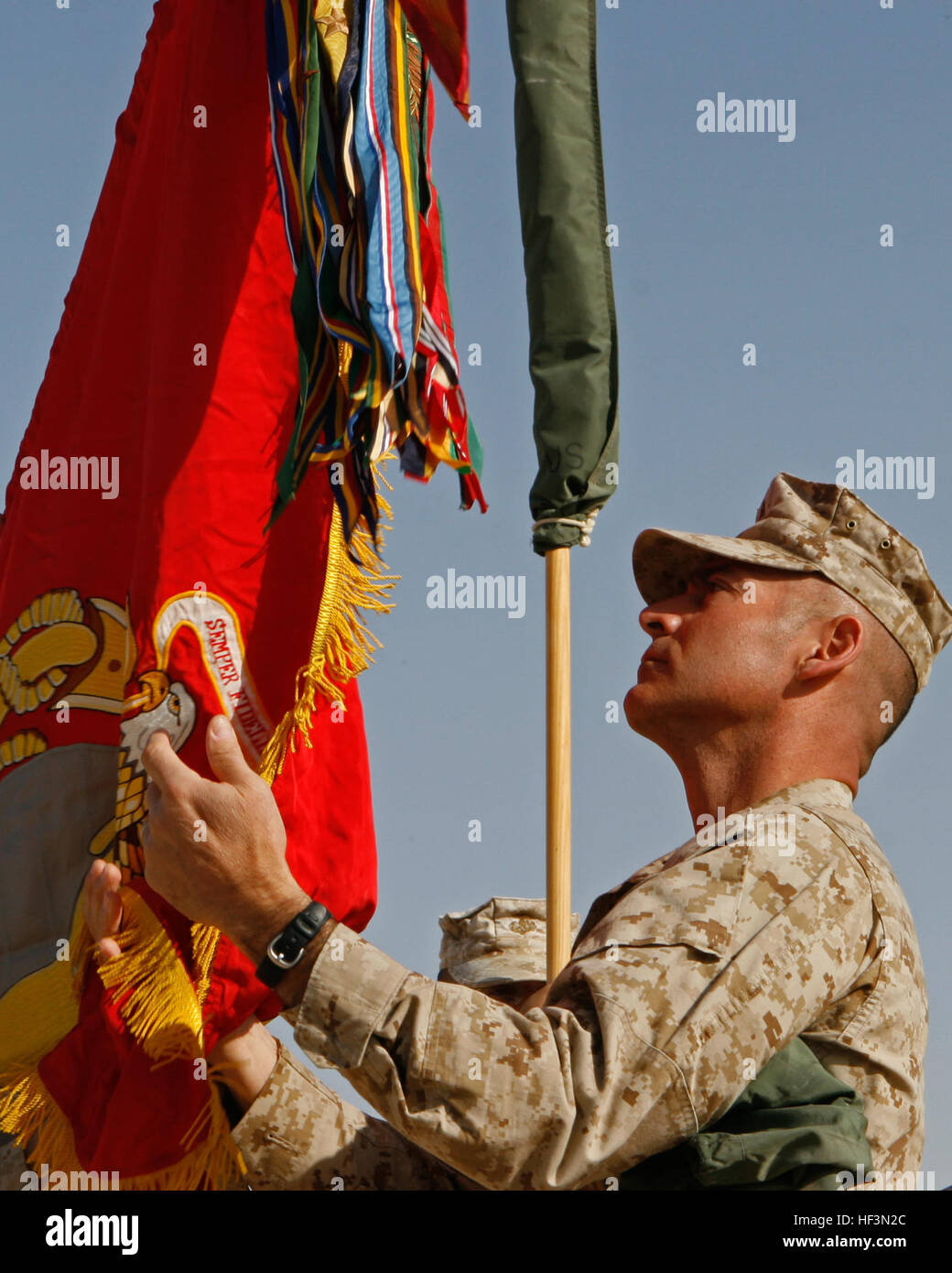 Lt. Col. Phillip Frietze, commanding officer, 7th Engineer Support Battalion, unfurls his battalion colors during - Stock Image