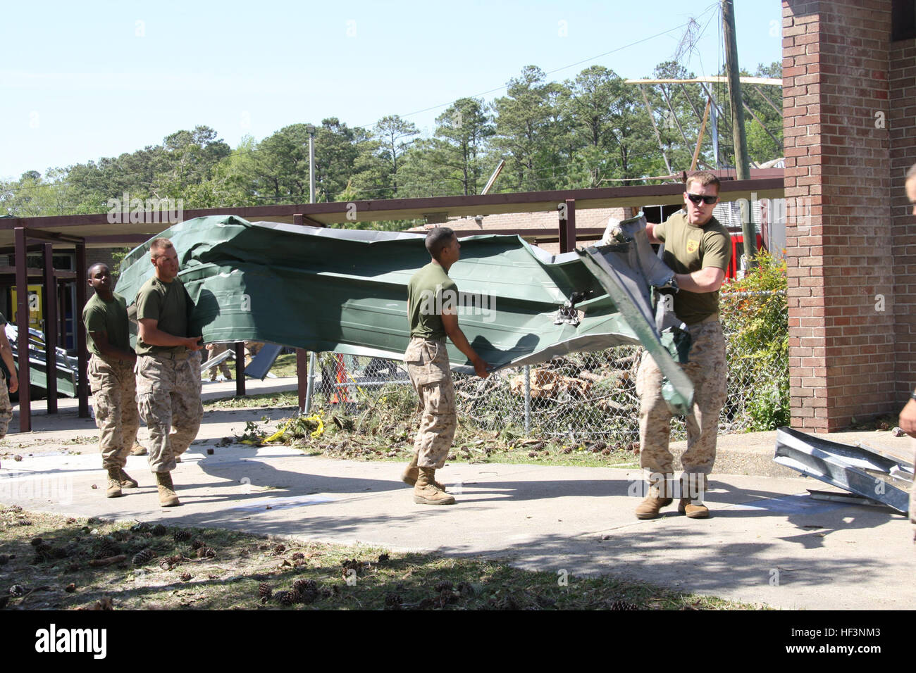 U.S. Marines remove tornado-damaged metal roofing April 18, 2011, from the Tarawa Terrace housing area at Marine - Stock Image