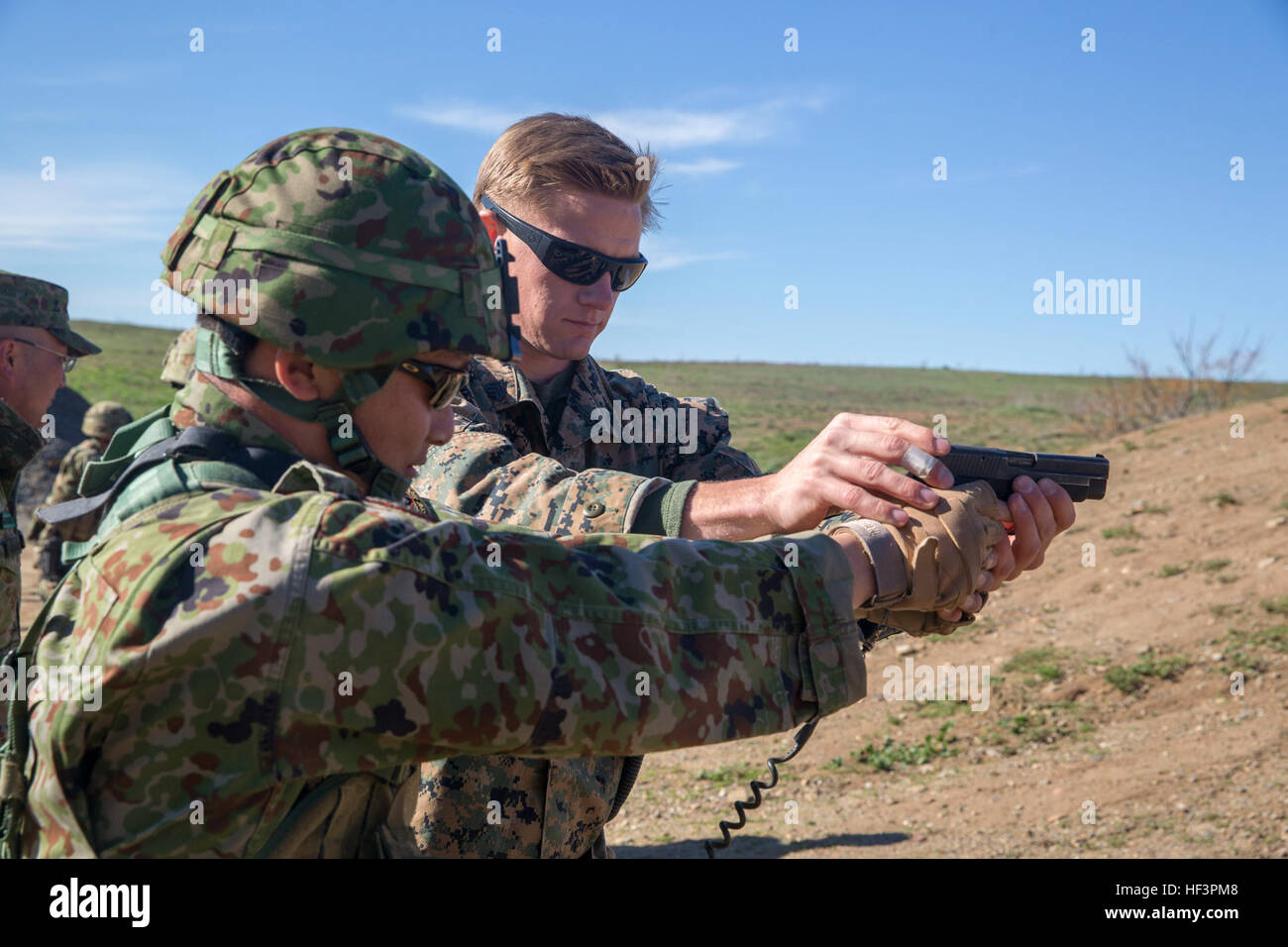 united states marine corps sgt mason wilhelmy scout sniper instructor 1st marine division schools assists a soldier of the japan ground self defense