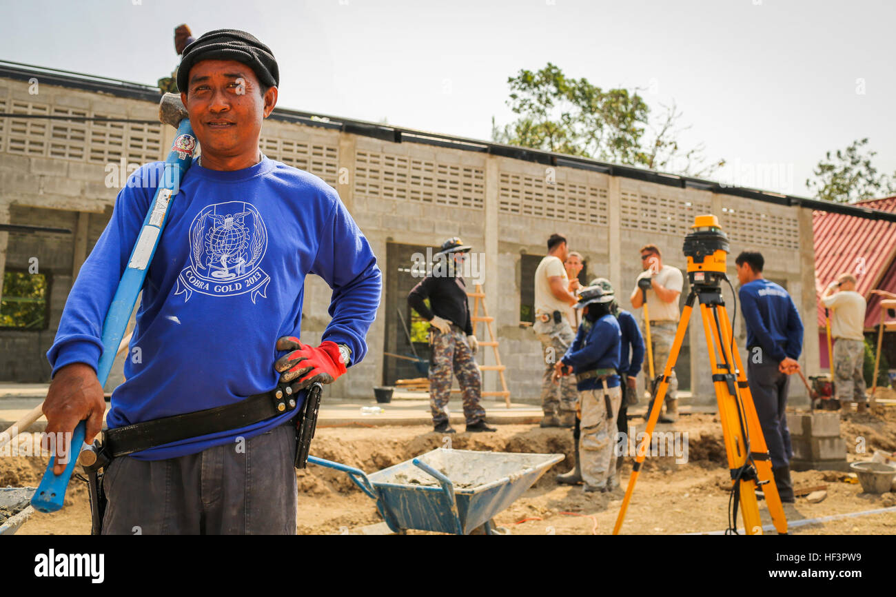 royal thai air force chief technician samaatt duenghaw poses for a photograph during the construction of a new classroom at the wat ban mak school