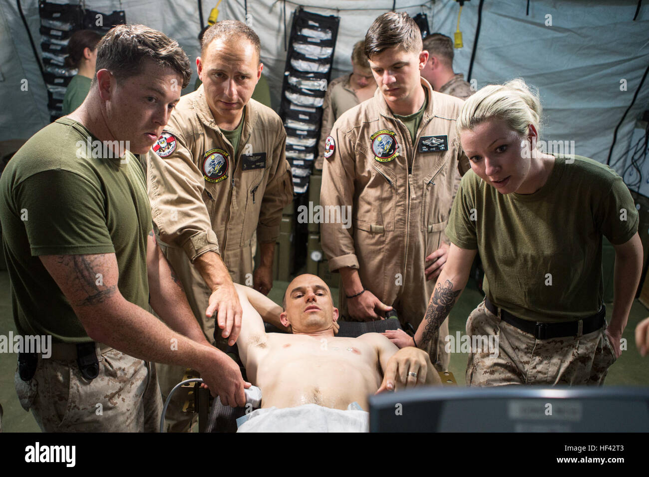 U.S. Navy Lt. Cmdr. Robert Oldt, an emergency physician and Lt. Oscar Kizhner, a flight surgeon, both with Special Stock Photo