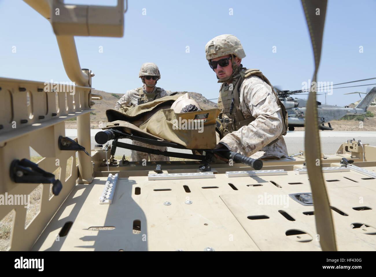 MARINE CORPS BASE CAMP PENDLETON, California (July 29, 2016)  – U.S. Navy corpsmen from 1st  Medical Battalion load Stock Photo