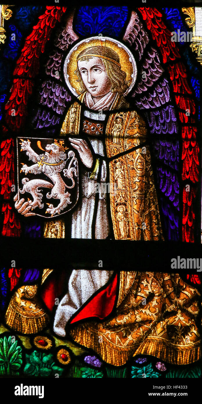 Stained Glass window depicting an Angel holding the Flemish Lion in the Cathedral of Saint Bavo in Ghent, Flanders, - Stock Image
