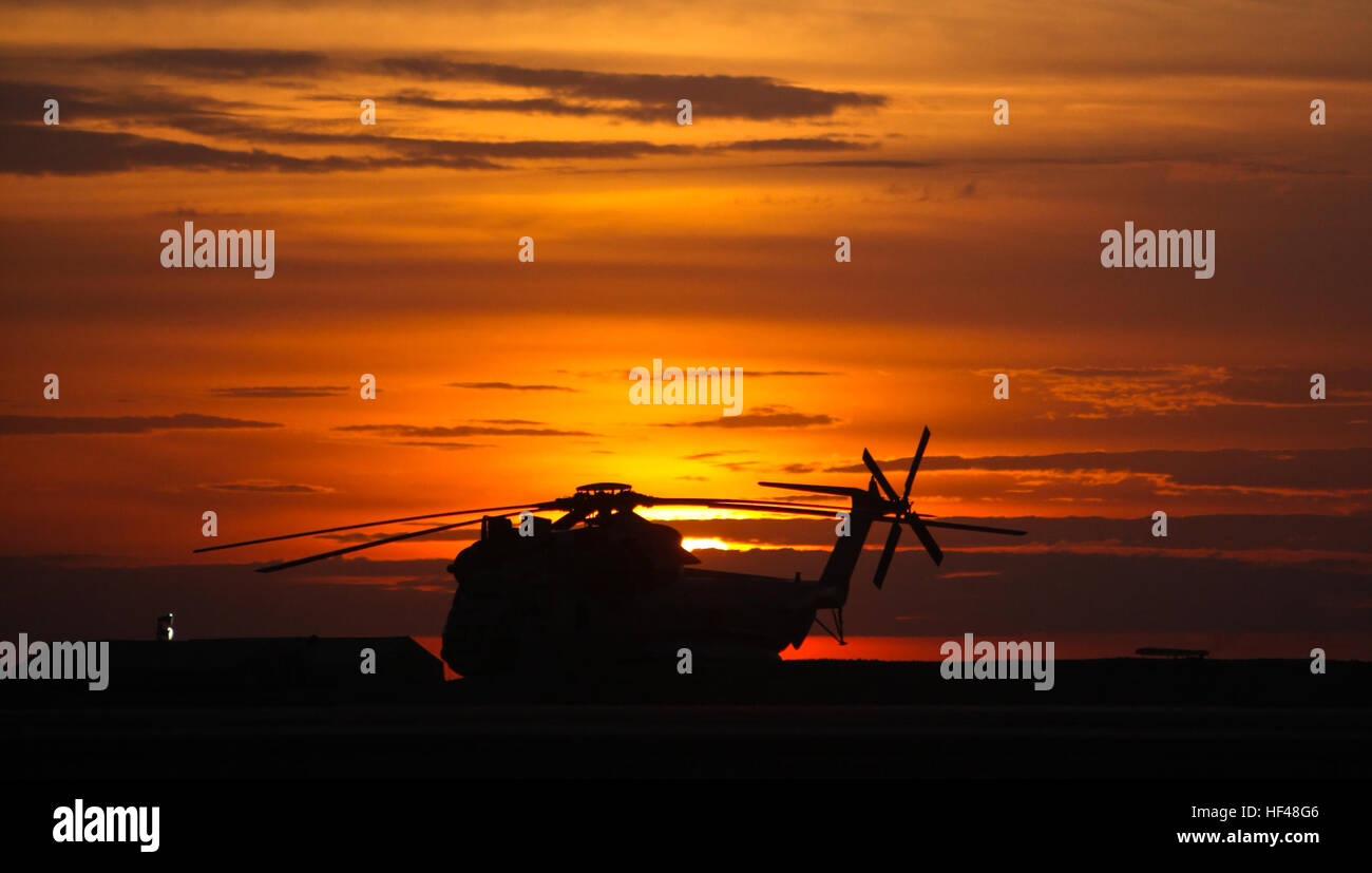 CAMP BASTION, Afghanistan - A CH-53D Sea Stallion from Marine Heavy Helicopter Squadron 363 sits on the flight line at sunrise here August 6.  A clear sky like this is a rarity for the only Delta squadron in Afghanistan; the unit's pilots often fly with lower fields of visibility due to the dust here. Sea Stallion at Sunrise DVIDS307052 Stock Photo