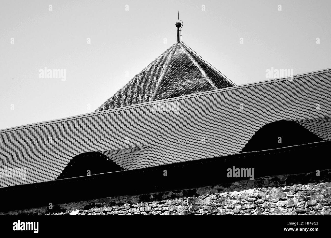 old architectural structures for romanian transilvania buildings with stone, tiled roofs, shingle roofs and eyeshaped - Stock Image