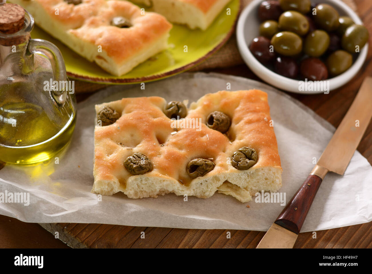 flat bread with green olives on the table - Stock Image