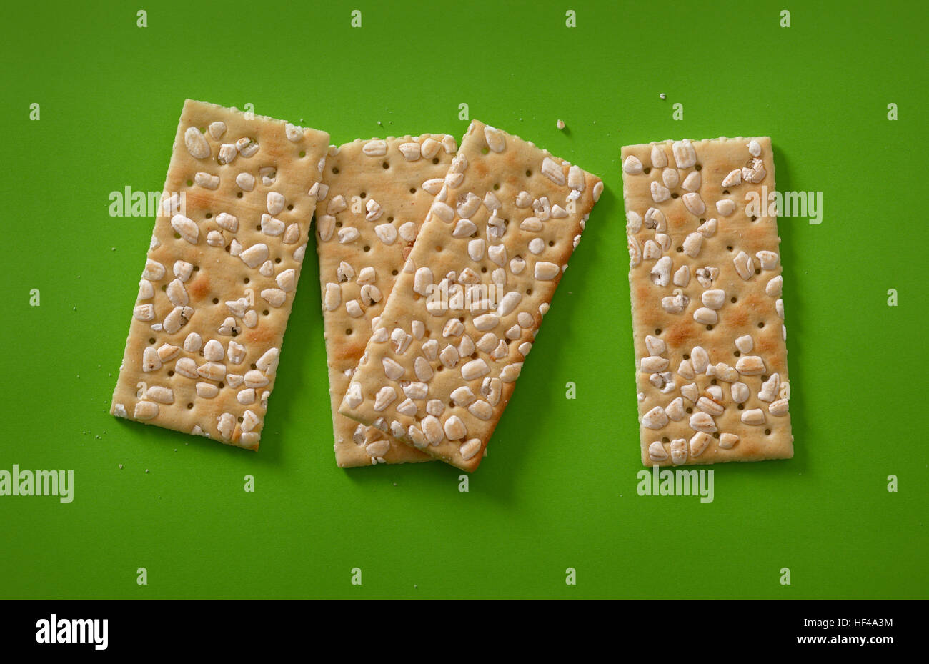 savory biscuits rice on the green table - Stock Image
