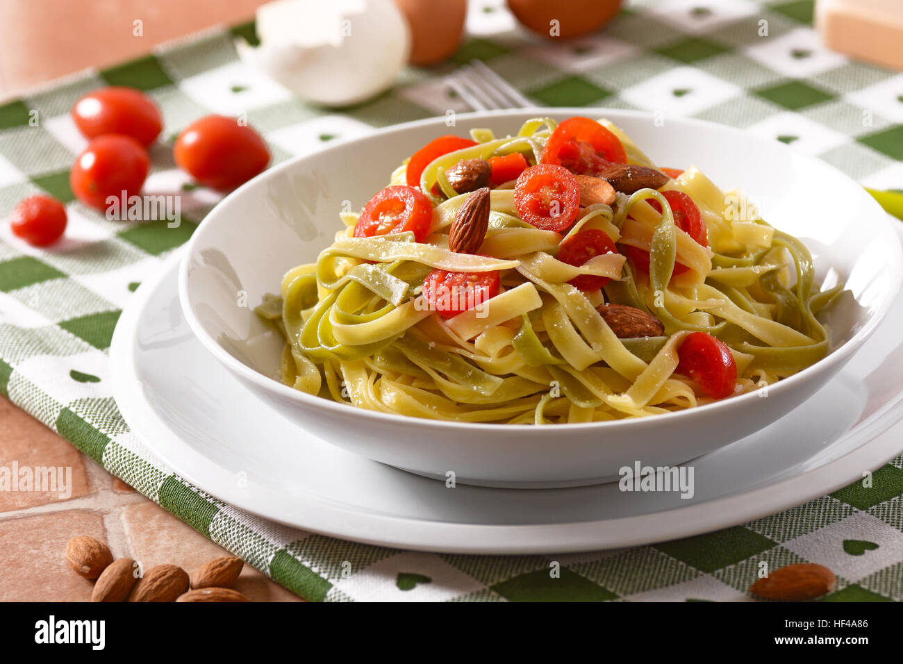 egg noodles with tomato and almonds - Stock Image