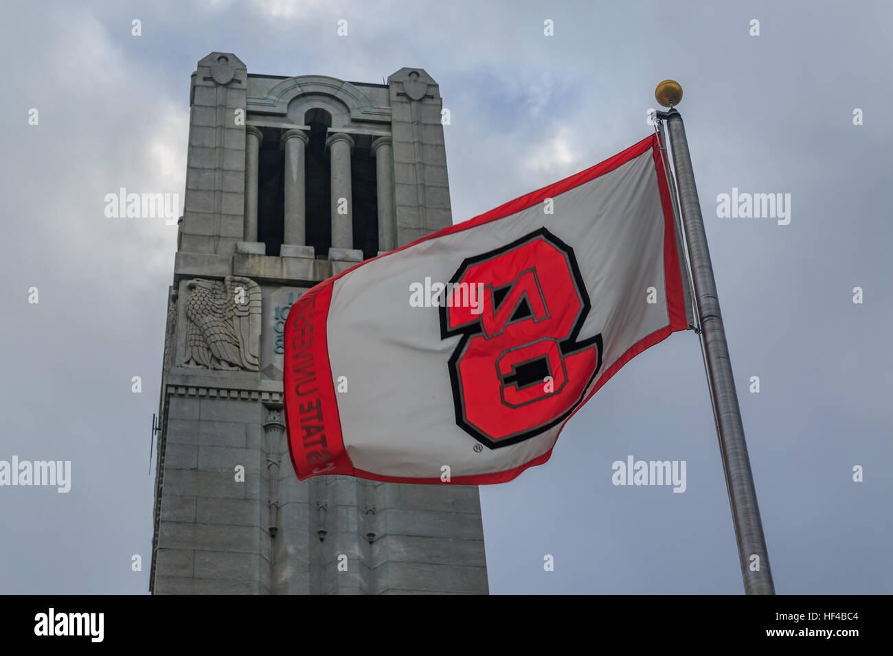 North Carolina State university flag with bell tower. Stock Photo