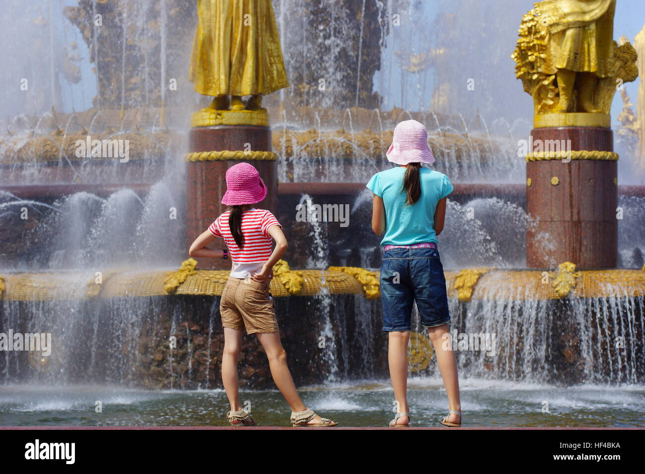 Girls at the fountain in the park at VDNKh on a hot summer day. Russia, Moscow, VDNKh. July 22, 2014 - Stock Image