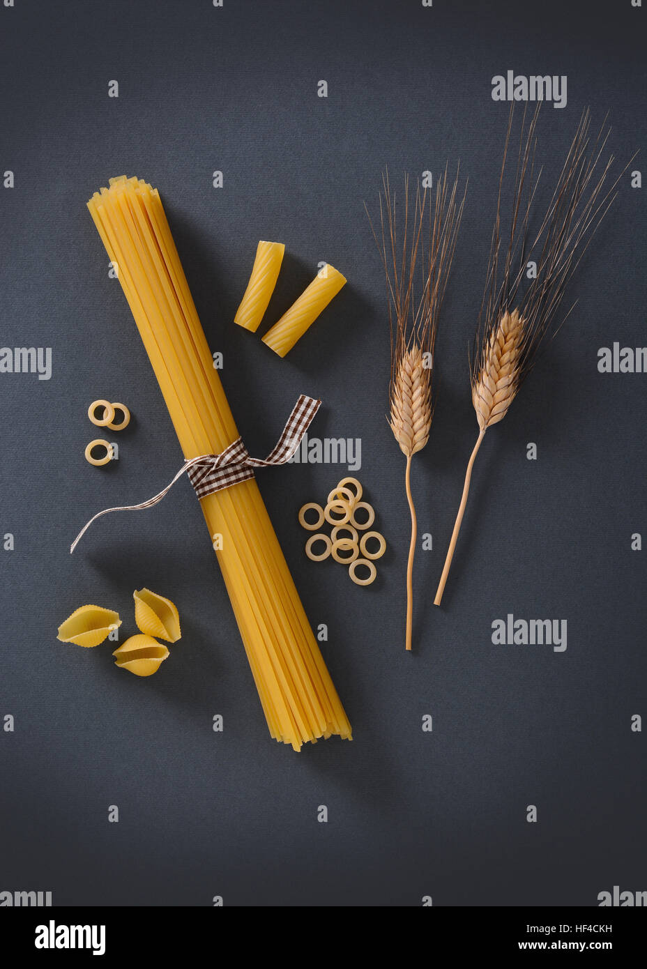 Italian pasta with ears of wheat near - Stock Image