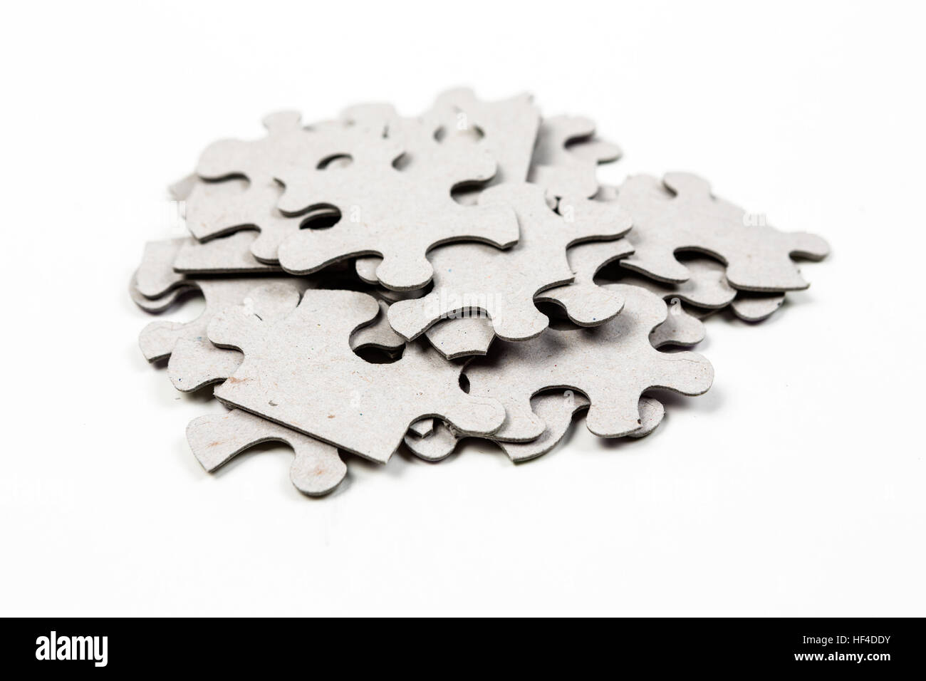 Pile Of Puzzle Pieces Isolated On White Background