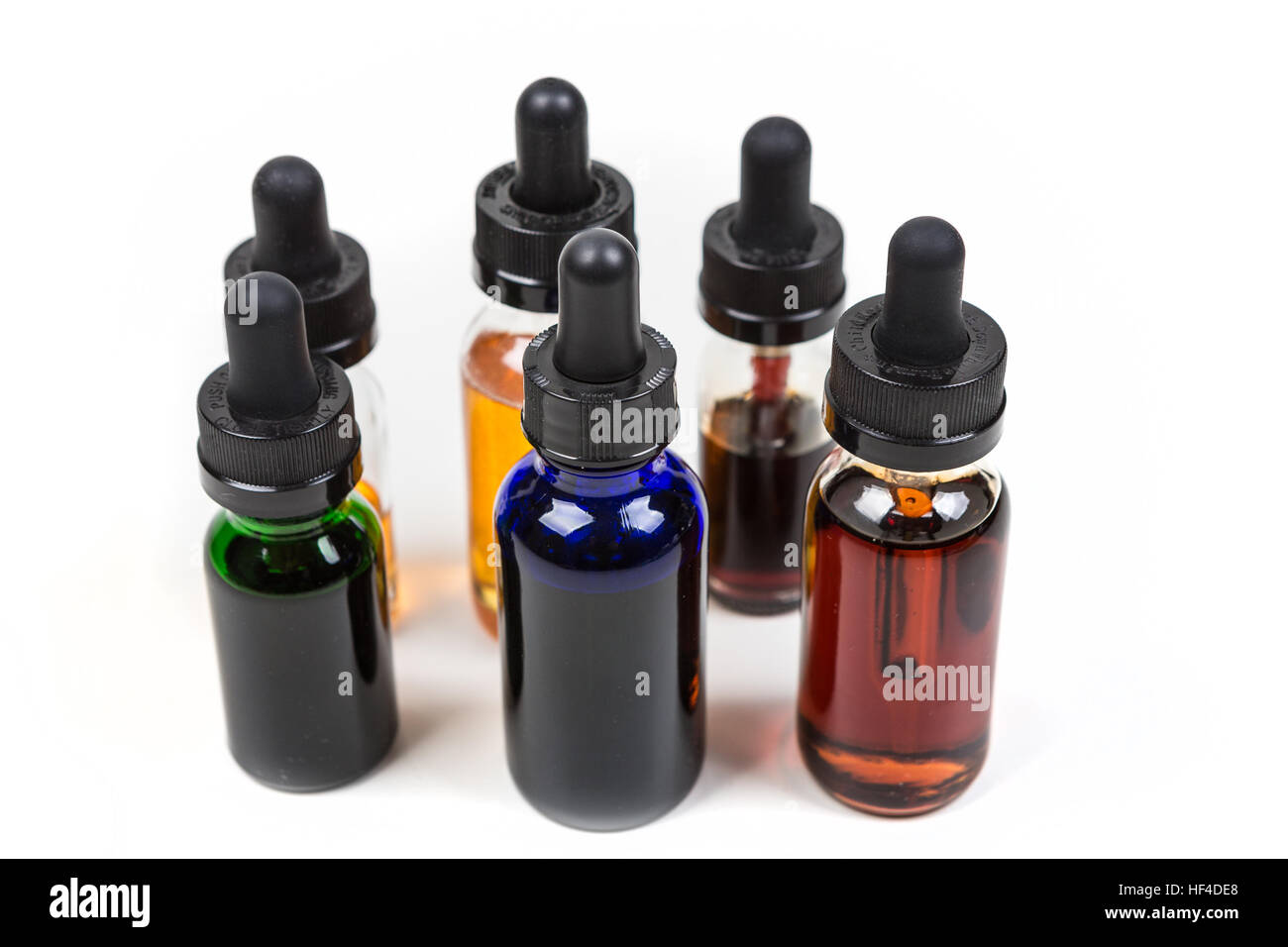 Assorted flavors of vape juice isolated on white background - Stock Image