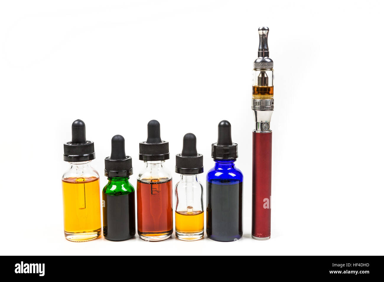 Assorted flavors of vape juice and an ecigarette isolated on white background - Stock Image