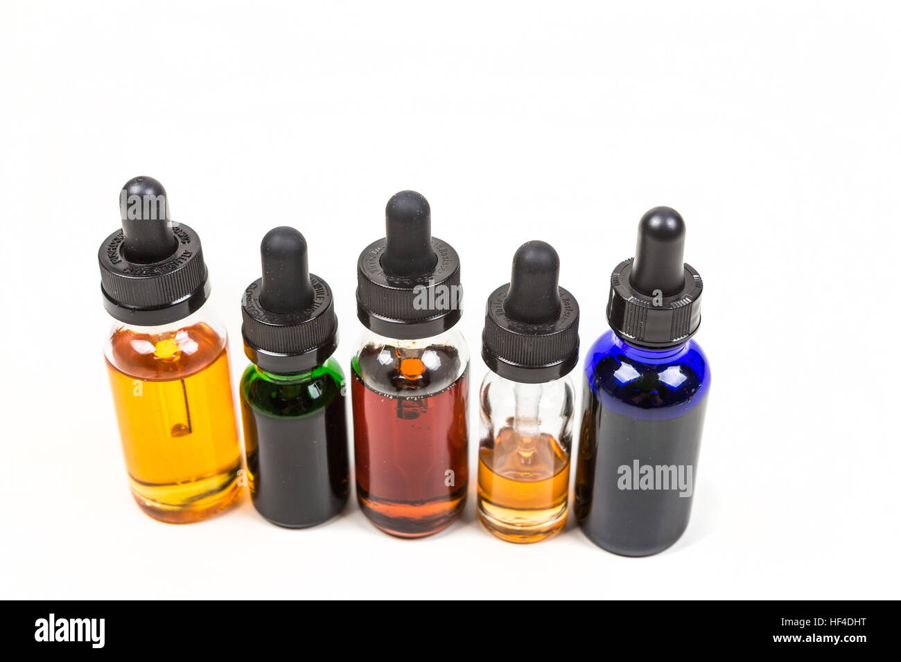 Flavored vape juice isolated on white background - Stock Image