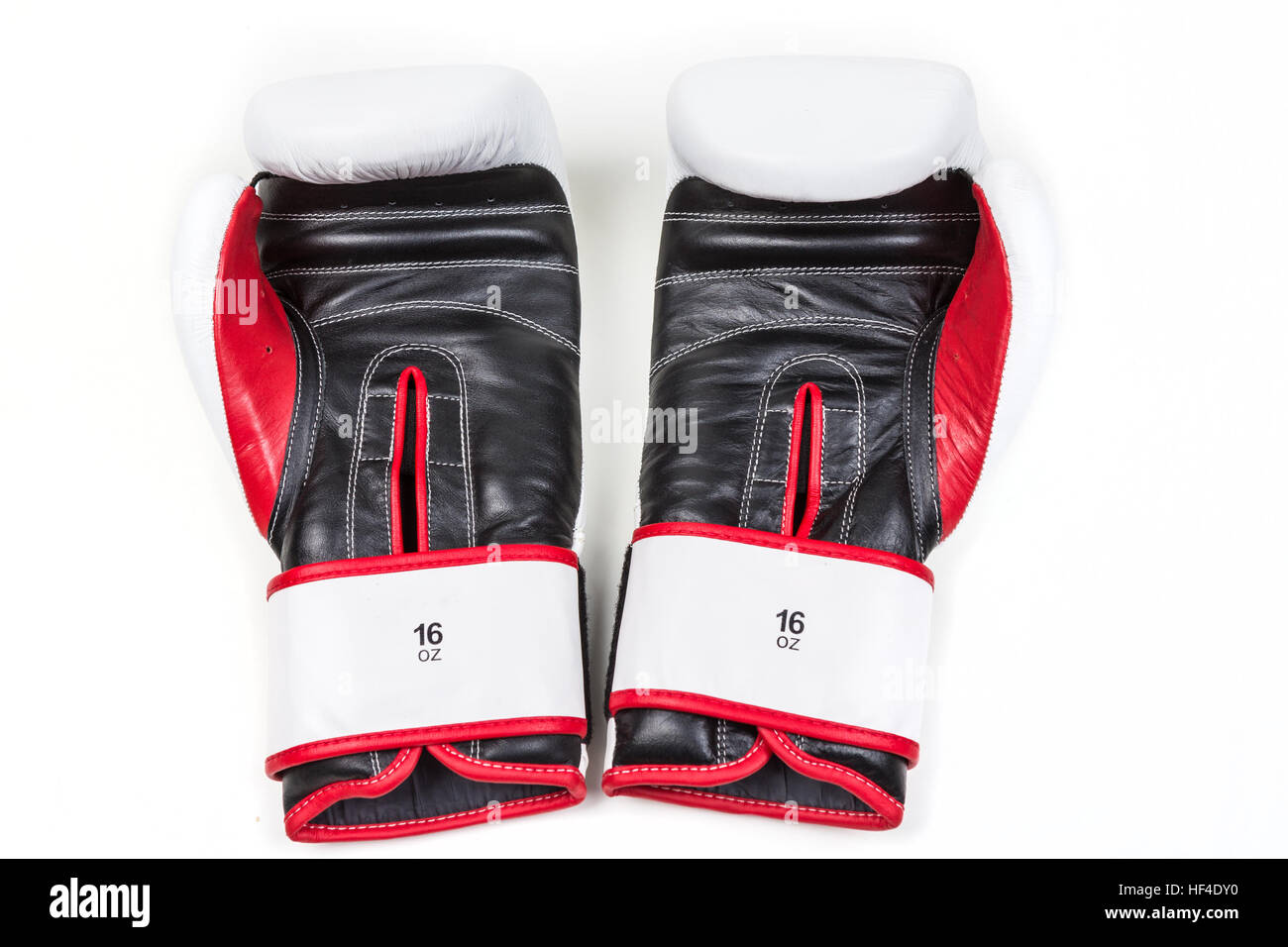 Pair of boxing gloves isolated on white background - Stock Image
