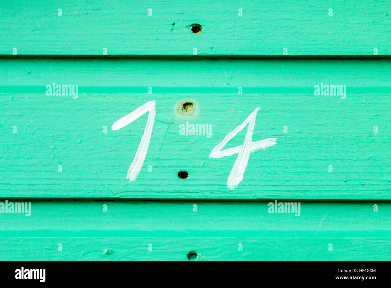 England, Whitstable. Number 14 painted white on green painted wooden boards. - Stock Image