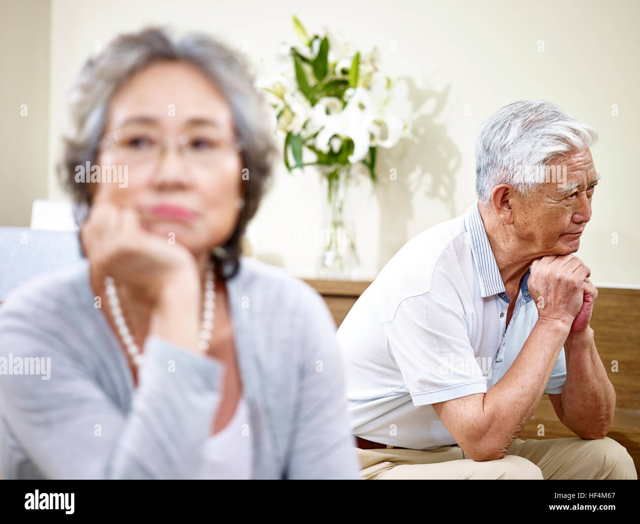 senior asian couple having relationship problem angry with each other. - Stock Image