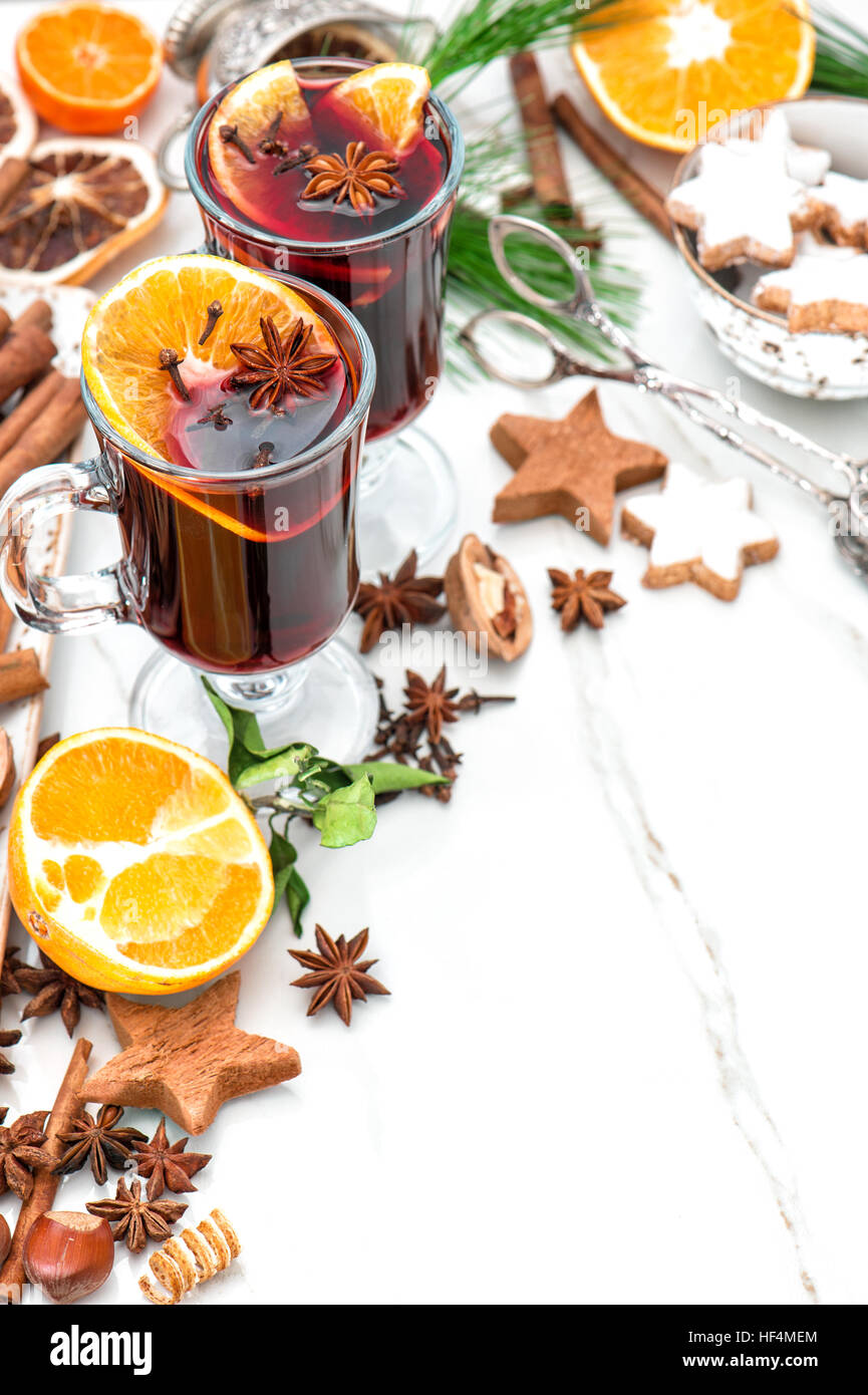 Mulled wine ingredients on bright background. Hot red punch with fruit and spices. Christmas food and drinks - Stock Image