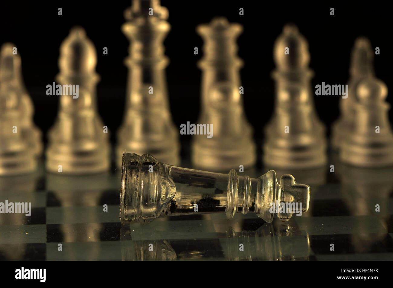 King lying on the chessboard . - Stock Image