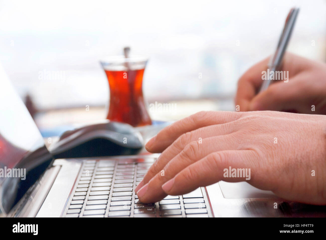 Businessman working with laptop Computer - Stock Image