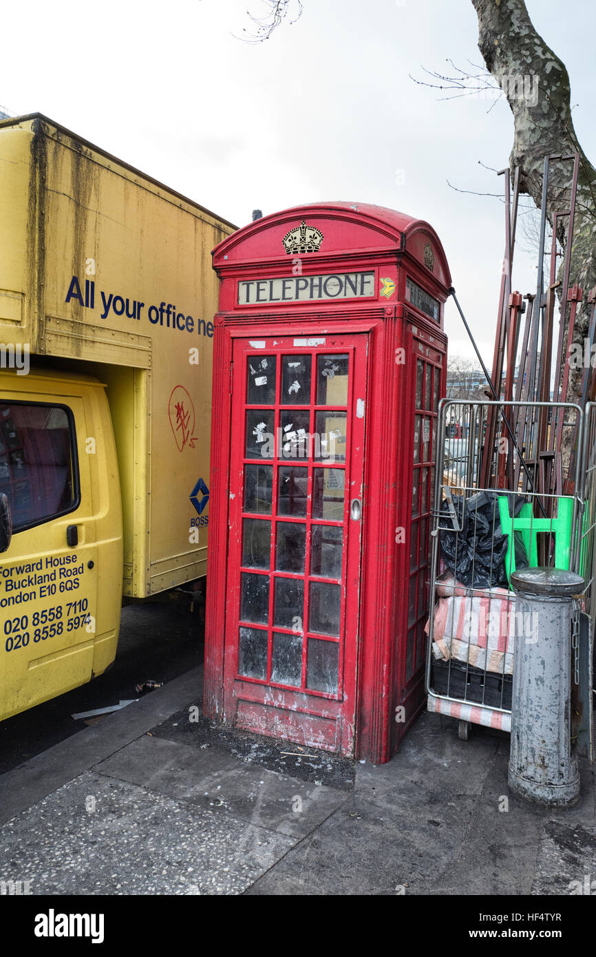 Red K2 telephone box designed by Sir Gilbert Scott and Grade II listed in Whitechapel - Stock Image
