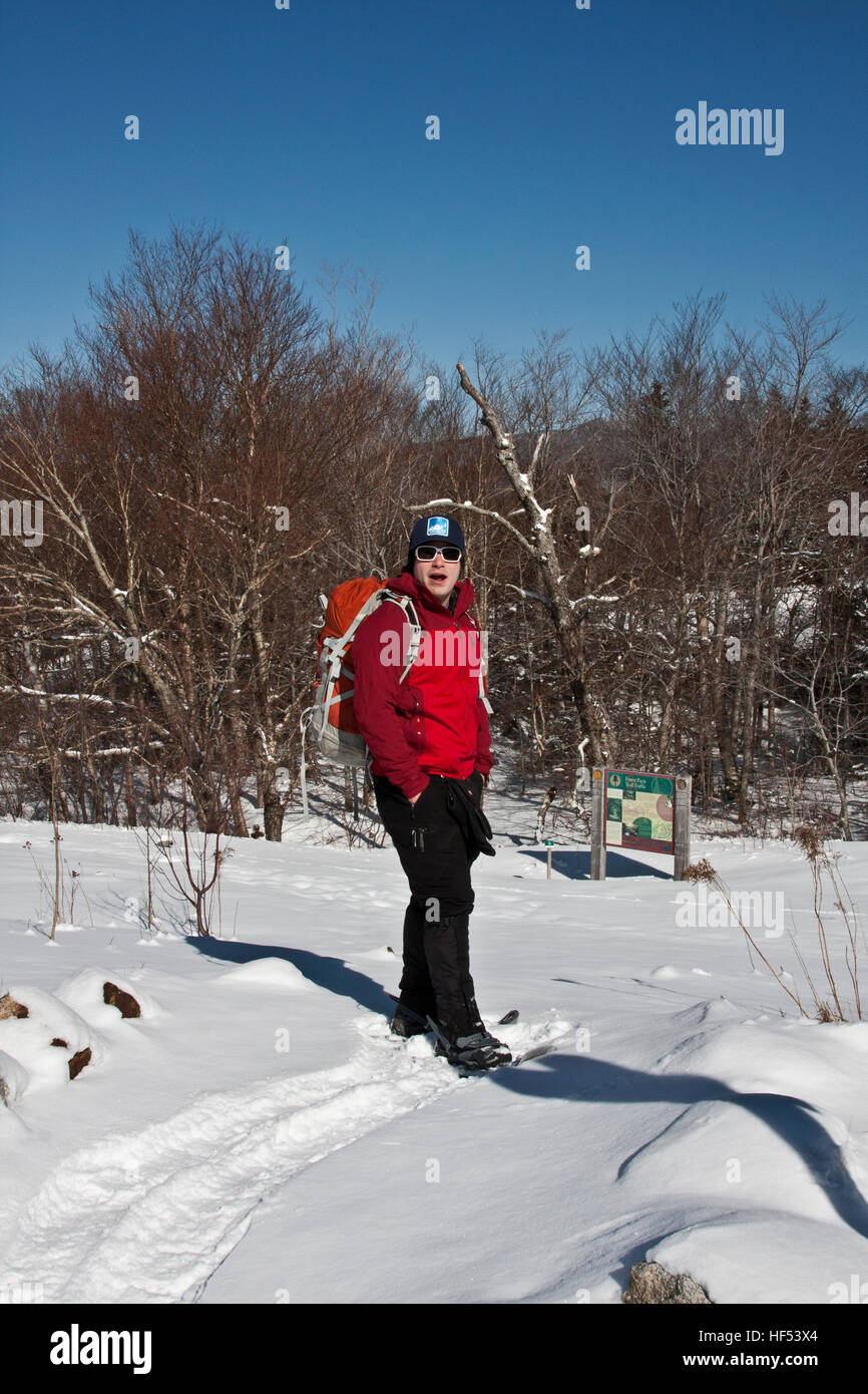 The Appalachian Mountain Club Highland Center at Crawford Notch, New Hampshire, USA, a snowshoe clad guide on the - Stock Image